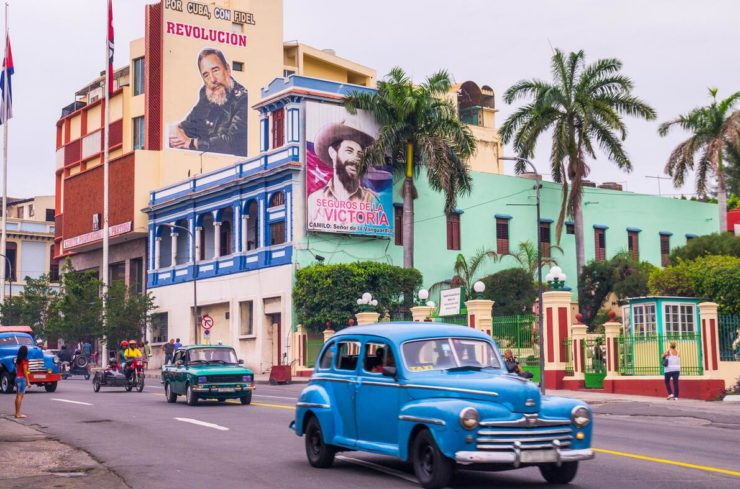 "Street with ""old-timers"" and propaganda in Santiago, Cuba."